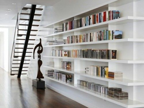 Create this wall-to-wall, floor-to-ceiling bookcase by simply using floating shelves. Major bookcase crush!