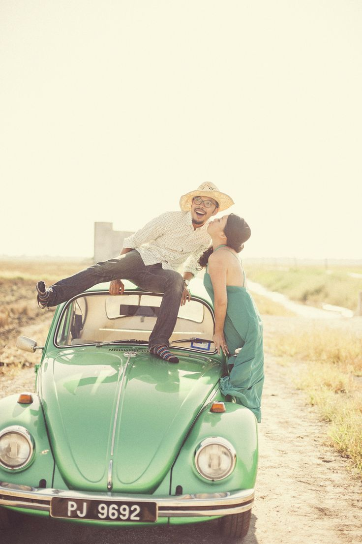 Fun engagement shoot in the paddy fields with a vintage Volkswagen Beetle in Selangor, Malaysia // Road Trip in a Vintage VW: Johan and Melissa's Engagement (Instagram: theweddingscoop)