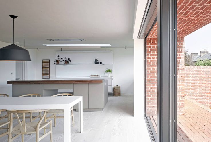 ​View of the kitchen from the dining area at the house at Broad Street in Suffolk (do Nash Baker Architects Ltd)