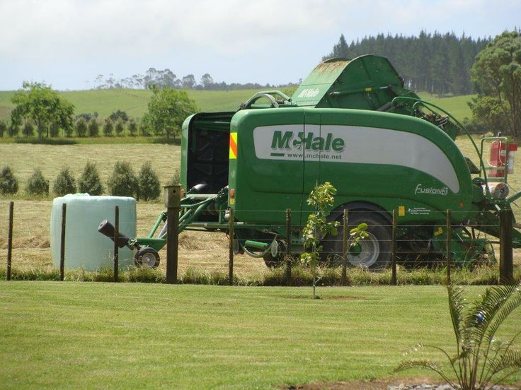 The completed silage bale pops out the back, wrapped and ready for pickup by the farmer to the storage point