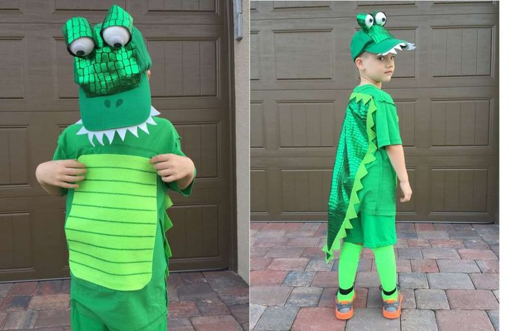 """ALLIGATOR: She writes: """"He is in Kindergarten and wanted to be an alligator just like his school mascot. I went to the big box store to see what I could put together and actually found some groovy alligator fabric and a green t-shirt on clearance! We already had some green pajama bottoms, a John Deere hat, soccer socks, felt, styrofoam balls, sharpies and googly eyes. With a little hot glue gun magic, we had an alligator costume in less than an hour at a cost of $14!"""