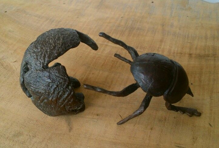 Dung beetle sculpture. Bronze edition of 150 by Malcolm Solomon