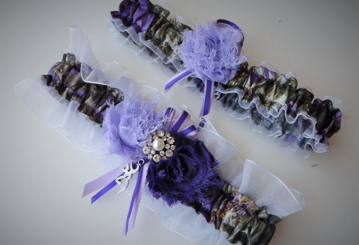 This adorable garter set is made of purple True Timber Mc2 Satin Camo print. They are embellished with lavender and purple shabby chic flowers, pearl and rhinestone brooch, lavender sheer organza and