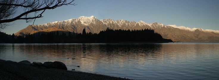 The Lake Foreshore in Queenstown and Snow Capped Mountains.