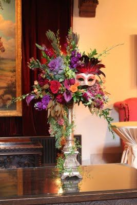 Parsonage Events  This is a sample of a masquerade centerpiece we did with similar colors and textures.
