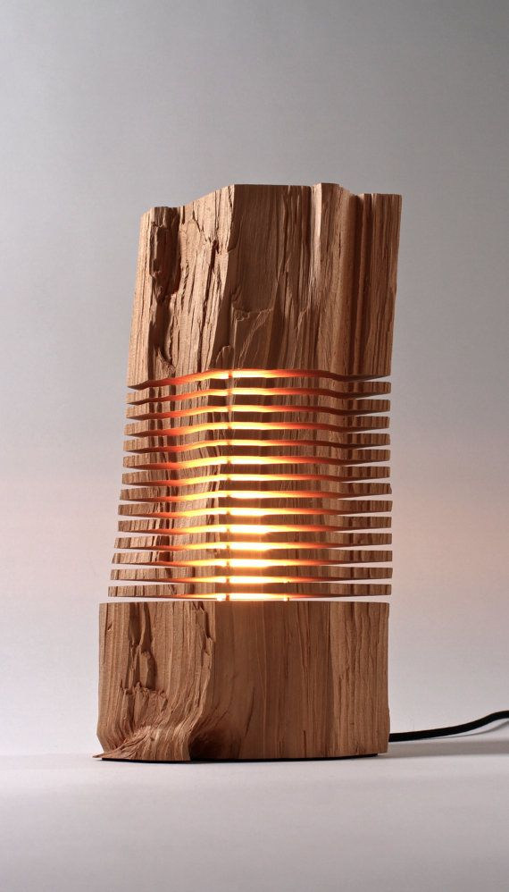 This lamp is unique, each piece of wood is different. That's the beauty of this piece of art.