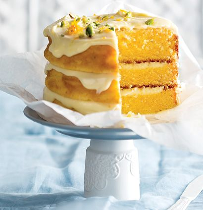 White chocolate cardamom and orange layered cake with white chocolate ganache