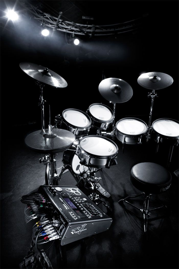 learn how to play the drums and totally rock out baby!  I used to take lessons as a kid so I have the basic rhythm, but come on, I want it all! ;)