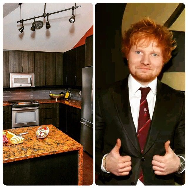 Ed Sheeran paired with a Manhattan Charcoal Textured Couture Kitchen by TheCabinetStudio.com featuring Aberdeen Cambria Countertops