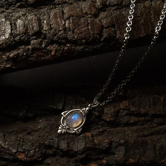 A precious handmade antique silver necklace with a unique vintage geometric antique sterling silver plated pendant and a high quality rainbow moonstone. Rainbow Moonstone is known to be a stone of love that provides calmness & protection, that has tones of pink, blue and milky white. The chain of the necklace is sterling silver of a very good quality with a silver fastening at the back to keep your necklace securely on at all times.  Each Rainbow Moonstone has been hand picked by me and they…