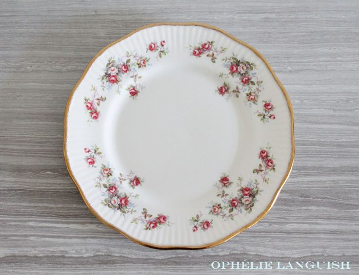 """Beautifully shabby chic set of two hand decorated fine bone china luncheon/salad plates in the Rosamond pattern. Previous editions of this pattern have been called """"Rosamund."""" Plates feature sprays of pink, white, and yellow roses. Ribbed rims and gold brushed edges."""