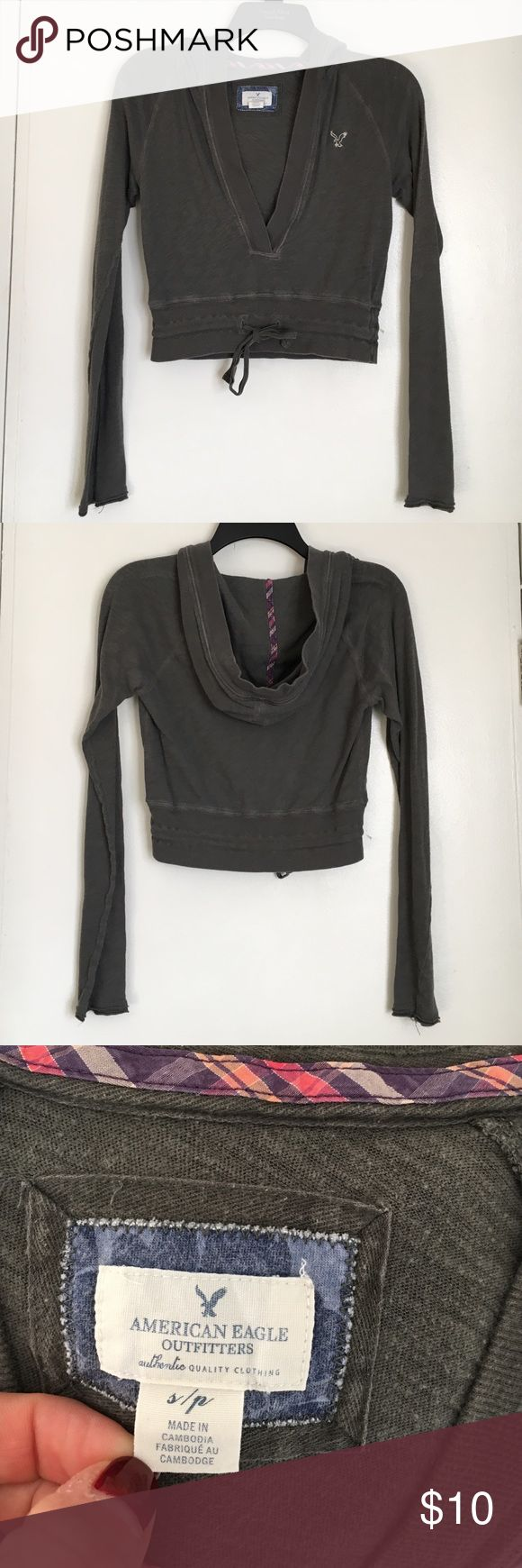 American Eagle Cropped Hooded Shirt Gray American Eagle long sleeved cropped hooded top. In good condition American Eagle Outfitters Tops Sweatshirts & Hoodies