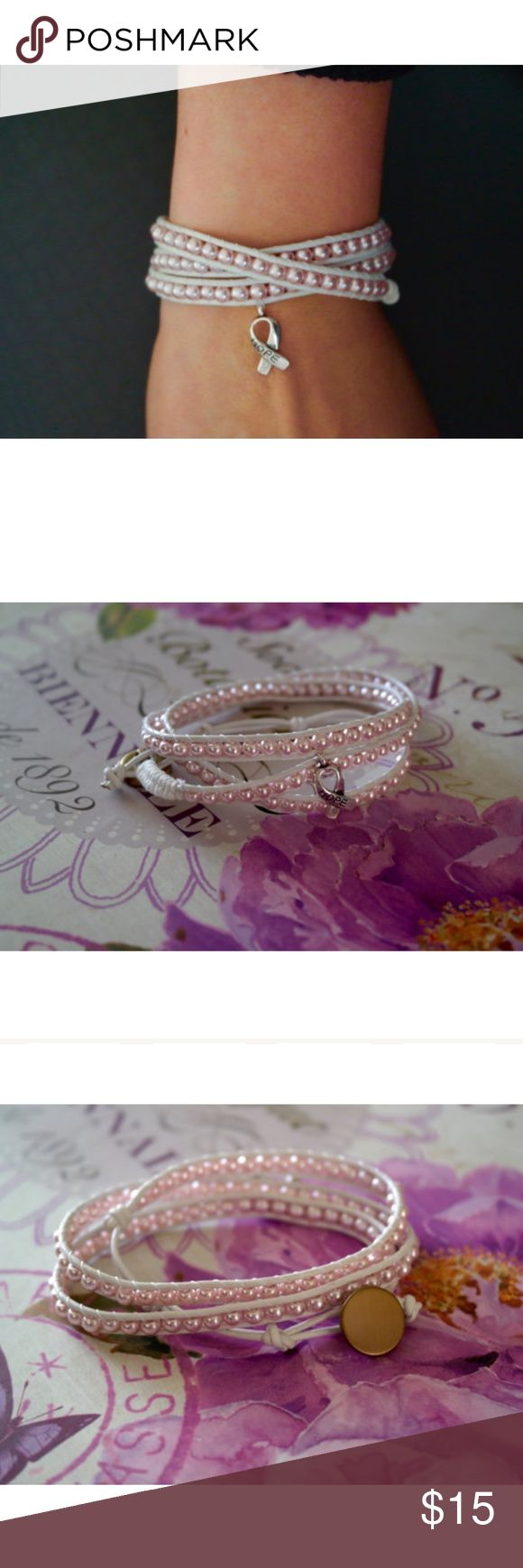 """NWOT. Breast cancer awareness triple wrap bracelet Breast cancer awareness wrap bracelet.  Light pink pearlescent beads with a hope charm and a gold antique button.  This is a triple wrap bracelet That has 3 holes for sizing.   Total length: 24"""" Jewelry Bracelets"""