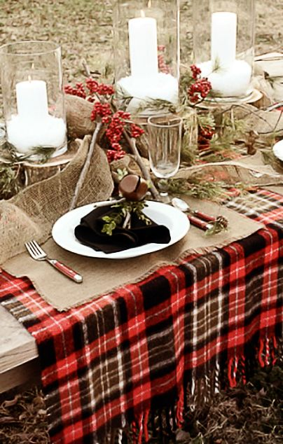 The tartan blanket serves as the perfect tablecloth for a holiday table  setting. The red berries, burlap placemats and hurricane lanterns pop  against the ...