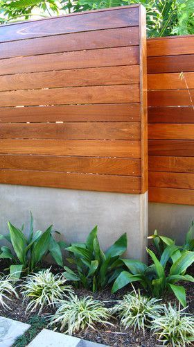 Mid century out door privacy fence. Cement block with stucco and horizontal fence.  Love!