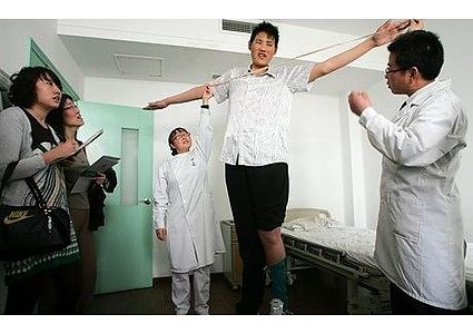 Zhao Liang 8 feet 1.1 inches tall.  Circus performer in China.