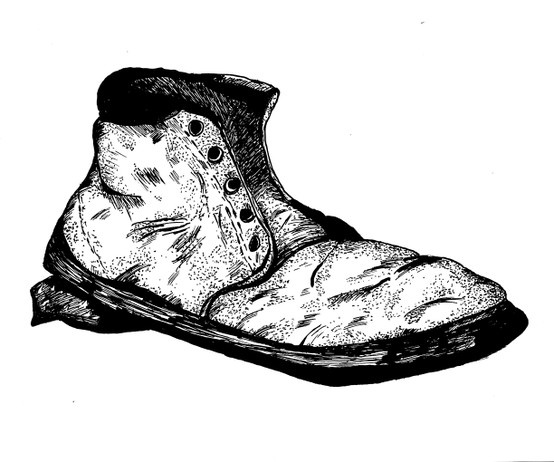 Estragon's obsession with his boots comes up throughout the play. this picture present Estragon and his boots.