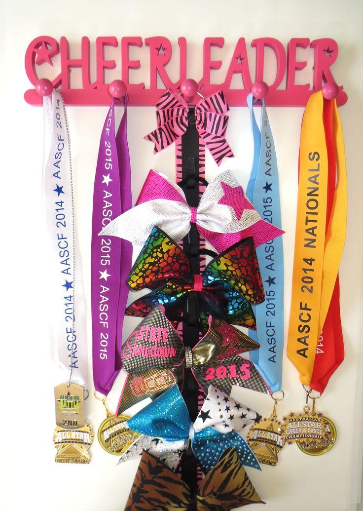 Perfect for a Cheer Themed bedroom <3 Cheerleader Medal Holder in Pink <3 #cheer #cheerleader #pink #cheerleading #cheerleaders #medal #medals #medalholder #medalhangers #cheerbows #cheerbow #sports #sportsmedals #bedroomdecor #décor #kidsroom #organised