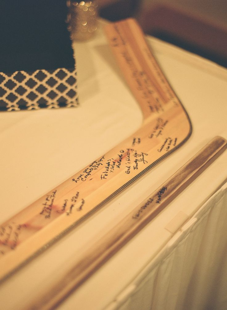Instead of a guest book our guests signed their wishes onto goalie sticks #guestbookideas #hockeywedding