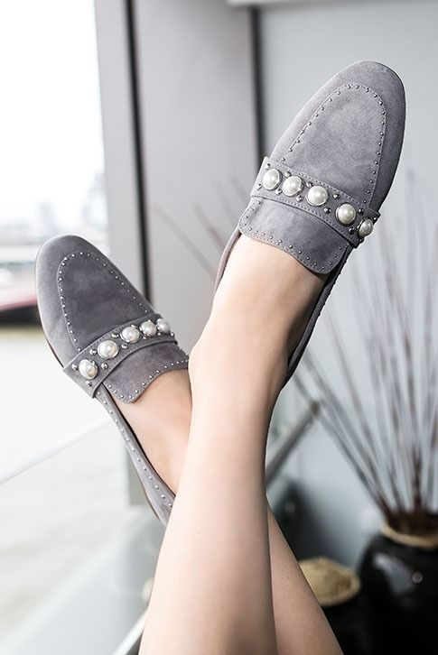 Luxe slip-ons are big news this season, so treat your capsule to brand new Leighton from Carvela Kurt Geiger. Set in grey, this easy loafer silhouette is upgraded through pearl and stud embellishments for extra style points.