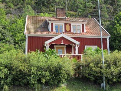 """Country house overlooking Lake Vattern in the small village of Vatta in southern Sweden. The """"Faluröd färg"""" (Falu-red color) has its origin from the copper-mines in the Province of Dalarna in mid-Sweden. The leftovers from the copper process was used to dye the color and it also has the very positive side effect of killing fungus that live on wood. This means that a wooden building regularly painted with """"Faluröd"""" will last for very long.."""