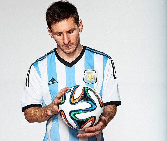 World in his hands: Lionel Messi will be hoping to lead Argentina to glory at next summer's showpiece in Brazil