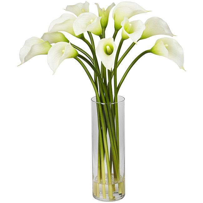 Introduce an element of elegance in your home or office with this silk lily flower arrangement. This decorative arrangement is constructed of durable polyester and is housed in a glass vase for an instant touch of sophistication in any space.