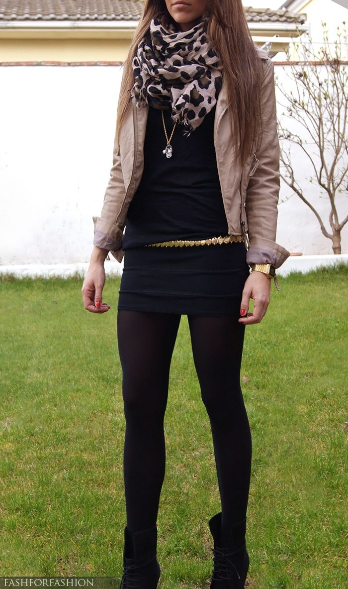 Black body con, see through back top, tights, black boots, nude blazer, leopard scarf. Loads of gold necklaces.