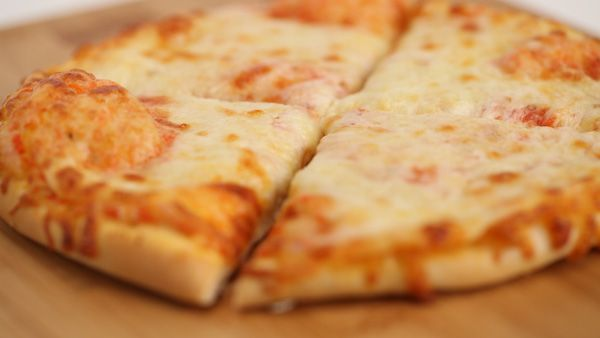 PERSONAL PIZZA DOUGH  A simple and straightforward dough for making a great personal pizza for a night in. Instead of the traditional toppings, try spreading butter or coconut butter, sprinkle with cinnamon and sugar and then drizzle with a little frosting for a small dessert pizza to share