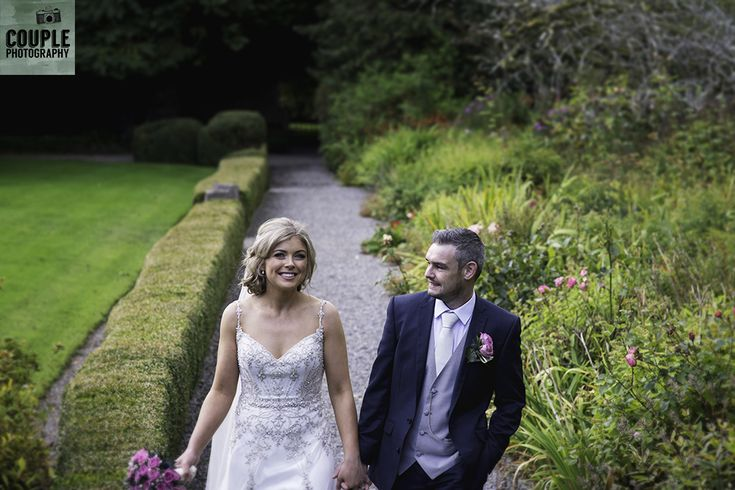 Michelle & Stephen in the grounds at Rathsallagh House. A real wedding from Couple Photography.