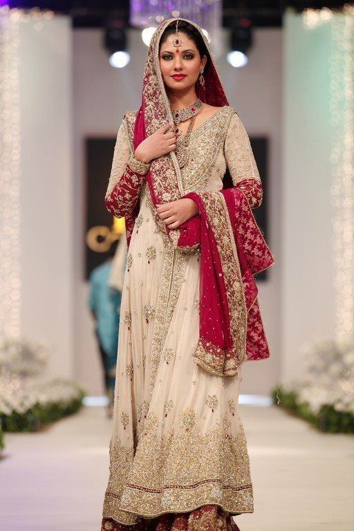 Love the combination of white and red! And the kaam on the neckline and bottom are so elegant! I can definitely see this as a great option for a fusion wedding (whether it be desi with Arab or American) where you may want to wear white, but also throw in a little desi kick. And the sleeves are perfect for a bride wanting a little more coverage than most bridal gowns allow.