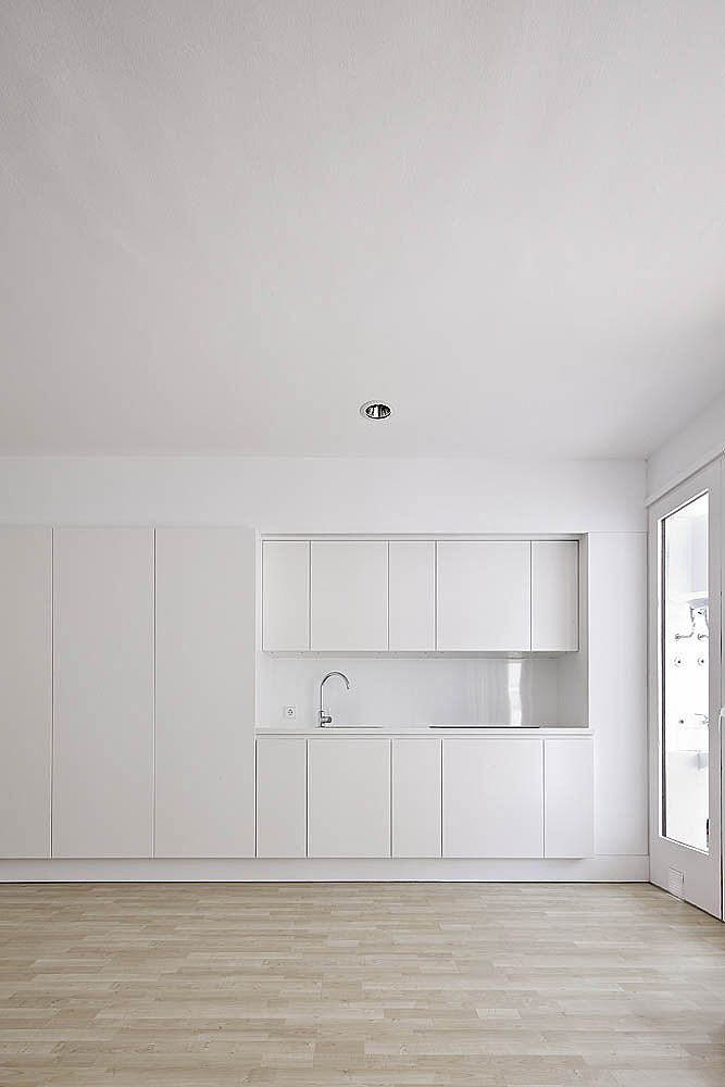 Kitchen integrated in a wall. Renovation of a small apartment in Ibiza by Marià Castelló.