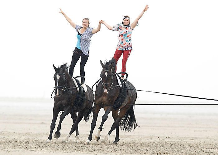 What?! Vaulting with two horses being lunged at the same time. Side-by-side. At the canter. On the beach. Sure...no big deal.