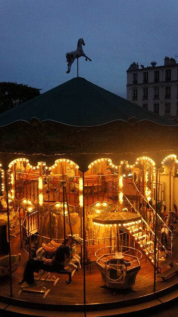 Old merry-go-round at Montmartre ~ Paris  Here the lights on the carousel of horses contributes to the fantasy world of a child's dreams and escape from the sometimes dreary and fast paced 21st century world we now live. in ... :)