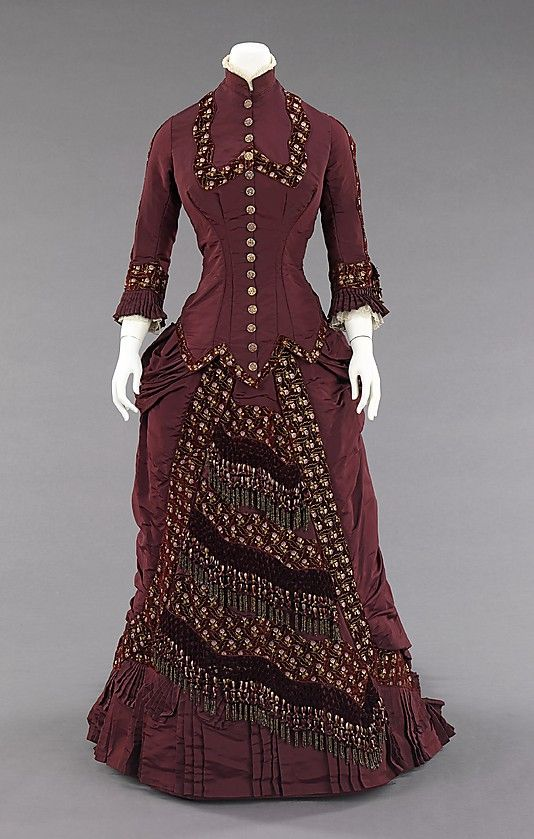 ca 1880. This dress belonged to Amelia Beard Hollenback (1844-1918), wife of the prominent financier and philanthropist John Welles Hollenback (1835-1927).  The elaborate button and tassel decorations, the overall cohesiveness of design and the high quality of this stylish dress are a testament to the craftsmanship and great attention to detail carried out by American dressmakers at this time.