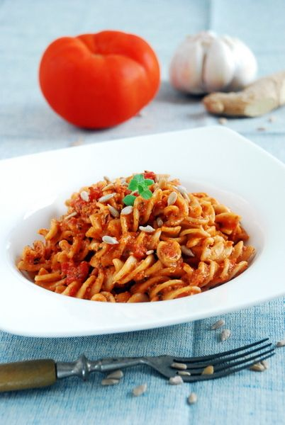 Tomato and coconut pasta with fresh ginger, garlic and roasted sunflower seeds.