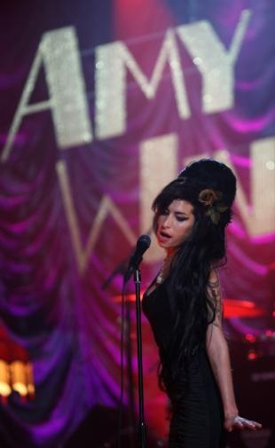 Though she performed via satellite from London, the late Amy Winehouse brought plenty of spunk to her performance on the 50th Annual GRAMMY Awards on Feb. 10, 2008