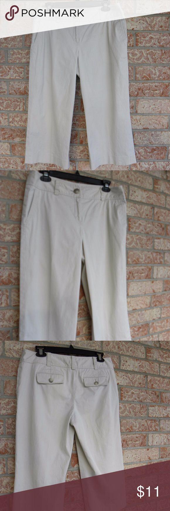 "Ann Taylor Capri Pants Khaki Size 8 Ann Taylor  Capri Pants  Khaki Color  Size 8  Women's pants Cotton  Measures flat surface one side waist: 17"" hips: 19  Zipper and button closure. Ann Taylor Pants Capris"