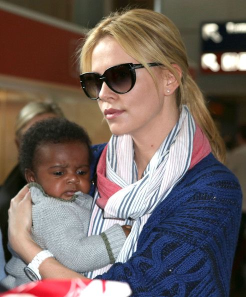Charlize Theron Diamond Studs - Charlize Theron wore a pair of pave diamond stud earrings while walking through the airport.