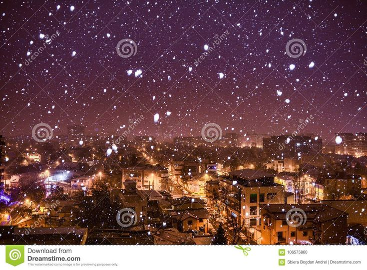Photo about First snow in Bucharest with big snowflakes. Photo taken from 10th floor. - 106575860