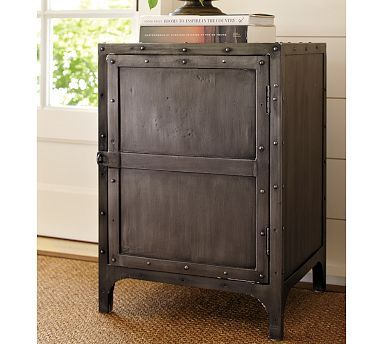 """...or a night stand...  Hawkins Indusctiral Tool Chest  $399.00 The right accent furniture can transform a space, adding individuality and a hint of history. Modeled after an antique tool chest and artfully painted to replicate the patina of aged steel, this table is a striking addition to a living room, entry or den.  19"""" wide x 17"""" deep x 27"""" high   Crafted of a kiln-dried hardwood with a steel frame.: Tools Chest, Living Rooms, Industrial Tools, Hawkins Industrial, Industrial Style, End Tables, Bedside Tables, Accent Tables, Pottery Barns"""