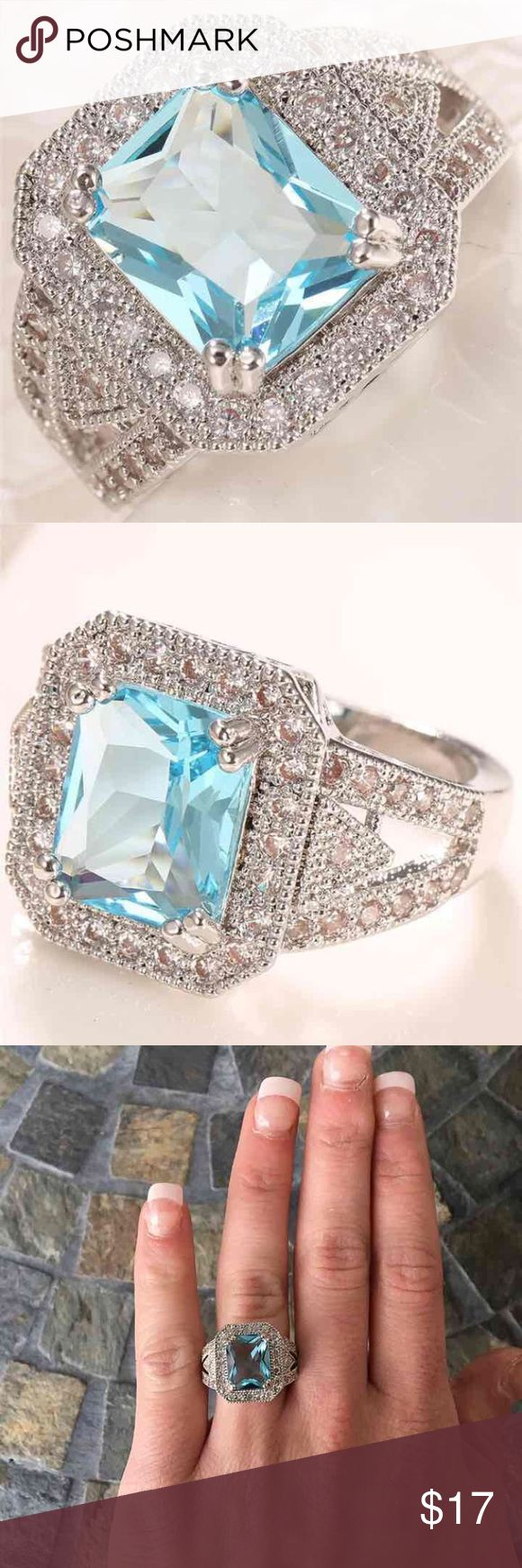 Emerald Aqua Halo Silver Engagement Ring Amazing sparkly ring! 3.7ct Aqua blue emerald cut center stone  Emerald shape halo setting  Pretty split band with a triangle design in the middle  White stones on all shanks of the band Silver plated  FIRM PRICE/NO TRADES❗ Jewelry Rings
