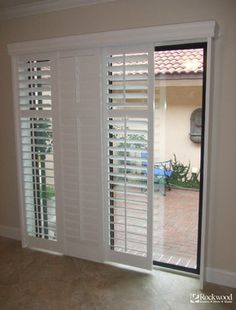 Plantation Shutters for Sliding Glass Door - Traditional - Window Treatments - Houston - Rockwood Shutters, Blinds and Shades