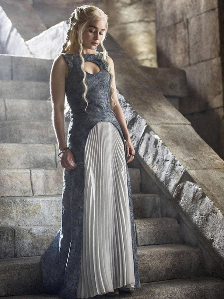Daenerys looks contemplative as she walks down the steps of a pyramid in Meereen (Game of Thrones)