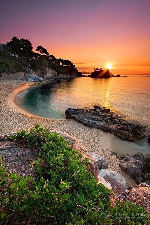 GIRONA SPAIN One day I will get to sit on a beach watching the sun set while drinking the wine made in that country.