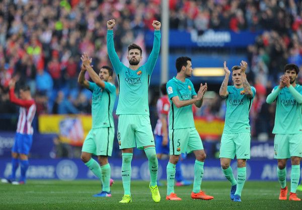 Gerard Pique of FC Barcelona celebrates with teammates after his team beat Club Atletico de Madrid 2-1 in the La Liga match between Club Atletico de Madrid and FC Barcelona at Vicente Calderon Stadium on February 26, 2017 in Madrid, Spain.