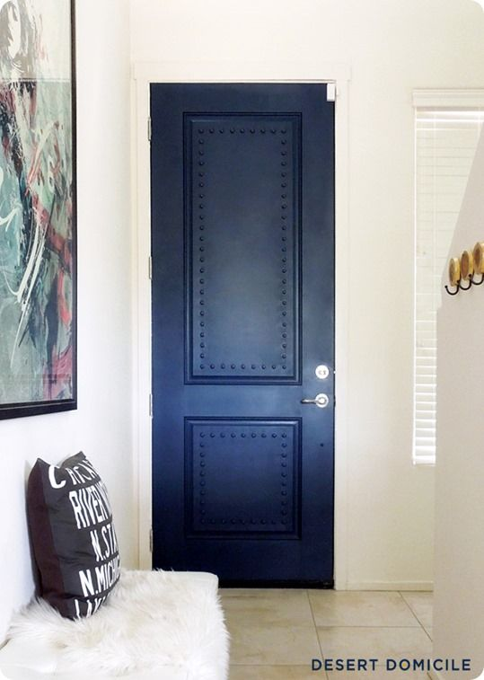 Are you a Big Bang Theory lover? If so, have you noticed those pretty studded apartment doors? Check out how to give a basic white door some personality with studs and navy paint!