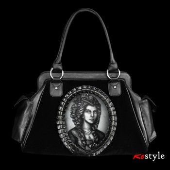 Handbag made of black velvet and faux-leather (poliuretan)In the middle is hologram picture of victorian lady with skeleton x-ray appears slowly on her. Picture is moving constantly, from side to side. By Restyle