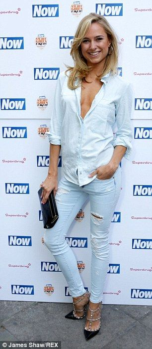 All-white: Kimberley Garner kept it real in light jeans and a plunging shirt...