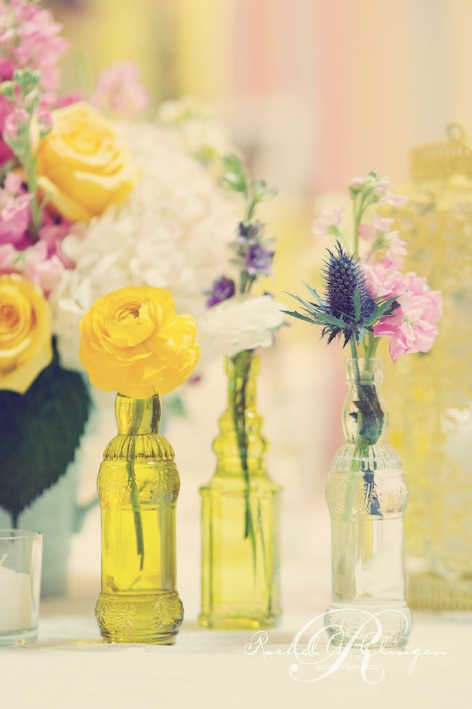 antique bottles with fresh cuts of small flowers are perfect for a vintage inspired wedding